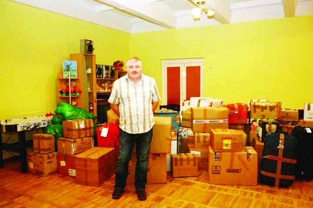 Greencastle man Seamus Carey donating hundreds of presents to children at a Lativan Orphanage last year. Seamus will travel to Lativa again in three weeks time.