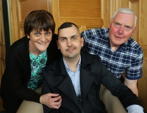 Mark Farren pictured with his parents Kathleen and Michael.