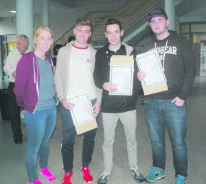 Ms Mulhall Rhys Davenport, Pauric Gillen and Ciaran Bonner at Leaving Cert Results day in Moville Community College