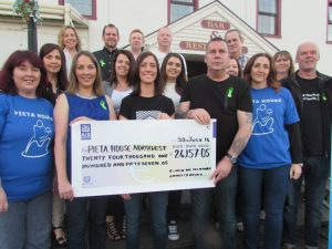 Members of the McMonagle family and friends presenting a cheque for Û24,157 to Paula Coyle Carberry and Anastacia Roache, from Action for Hope, representatives ofÊthe fundraising committee for Pieta House North-West.