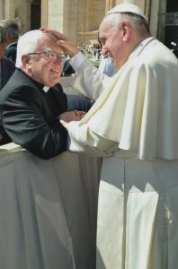 Thanks boss! Smiling Fr George accepts the warm wishes of Pope Francis to celebrate his sixty years in the priesthood.