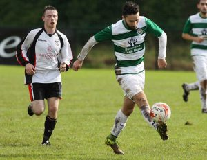 Cockhill's Jimmy Bradley in action against Letterkenny Rovers