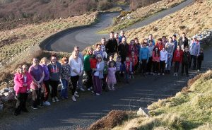 Families pictured on Mamore Gap last year as they embarked on a campaign to maintain free school bus transport from Urris to Carn Community School.