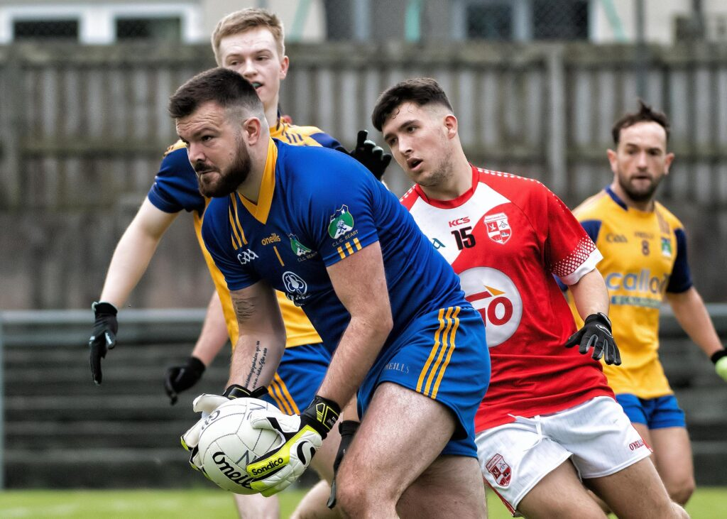 Burt's Aaron Coyle cuts out this attack by Naomh Colmcille's Shane Monaghan during Saturday's play off. Photo Evan Logan