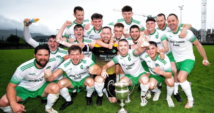 Clonmany Shamrocks celebrate with the Fr O'Gara Cup after Saturday's final. Photo Evan Logan