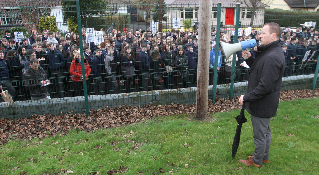 Crana College principal Kevin Cooley addresses a march for a new school back in February.