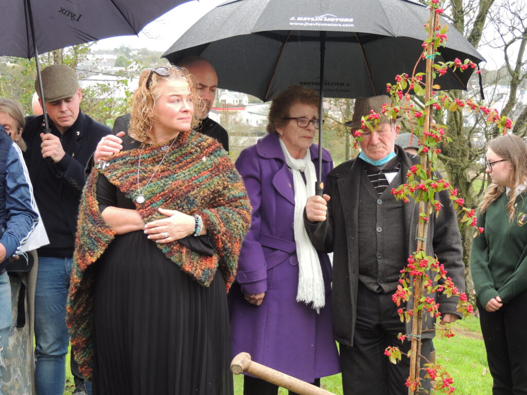 Geraldine Mullan gazes at the tree planted in memory of her son, while Tomás' grandparents Martin and Margaret Connaughton look on.